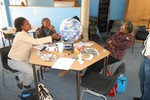 Educators using the Earth Ball to discuss distinguishing features of planet Earth