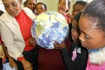 Learners pointing out Cape Town using the Earth Ball