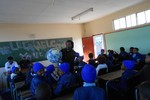 Sivuyile using the Earth Ball to explain astronomical concepts during his National Science Talk